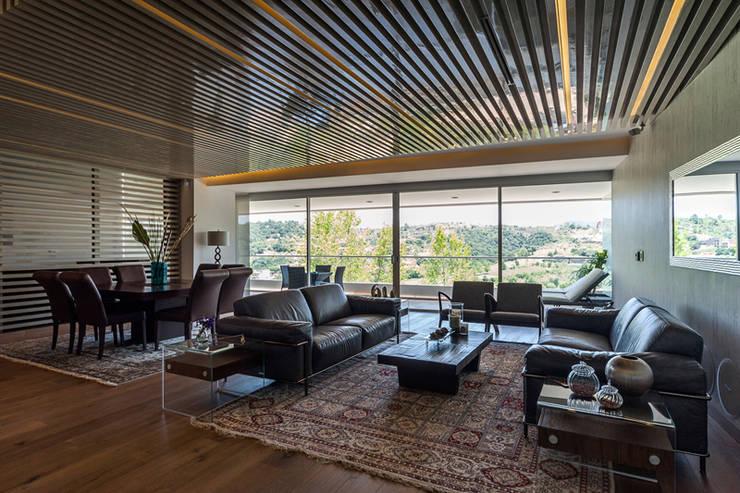 DEPARTAMENTO EN BOSQUE REAL: Salas de estilo  por HO arquitectura de interiores