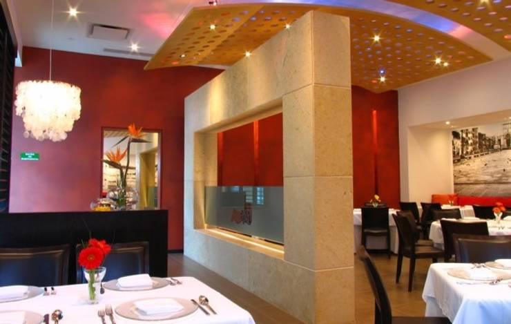 Restaurant Lo Sputino: Comedor de estilo  por BAO