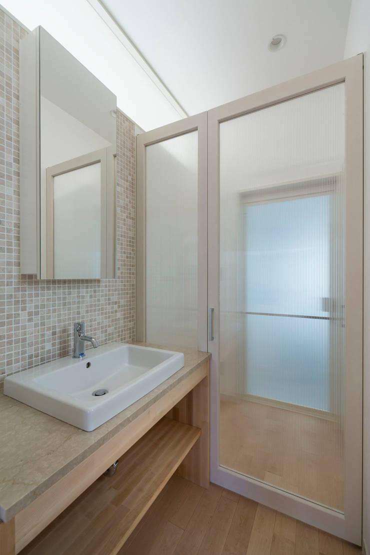 大岡山の家: (有)伊藤道代建築設計事務所が手掛けた浴室です。,