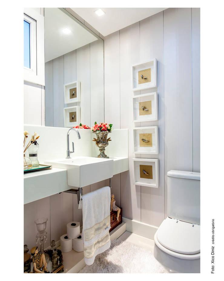 Lavabo romântico: Banheiros  por Cristiane Pepe Arquitetura