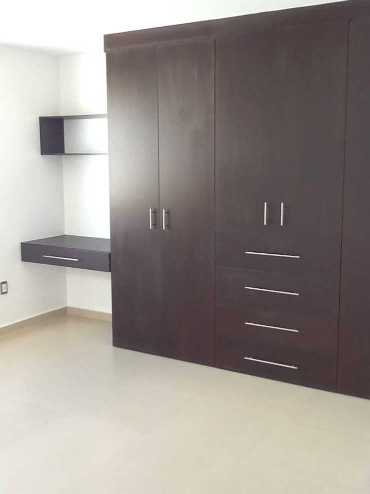 Habitación: Recámaras de estilo  por SANTIAGO PARDO ARQUITECTO