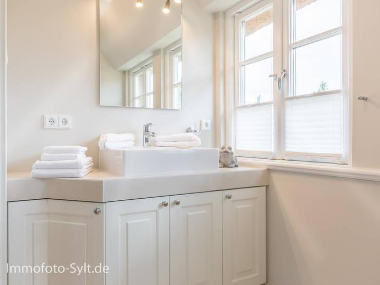 Ванные комнаты в . Автор – Immofoto-Sylt