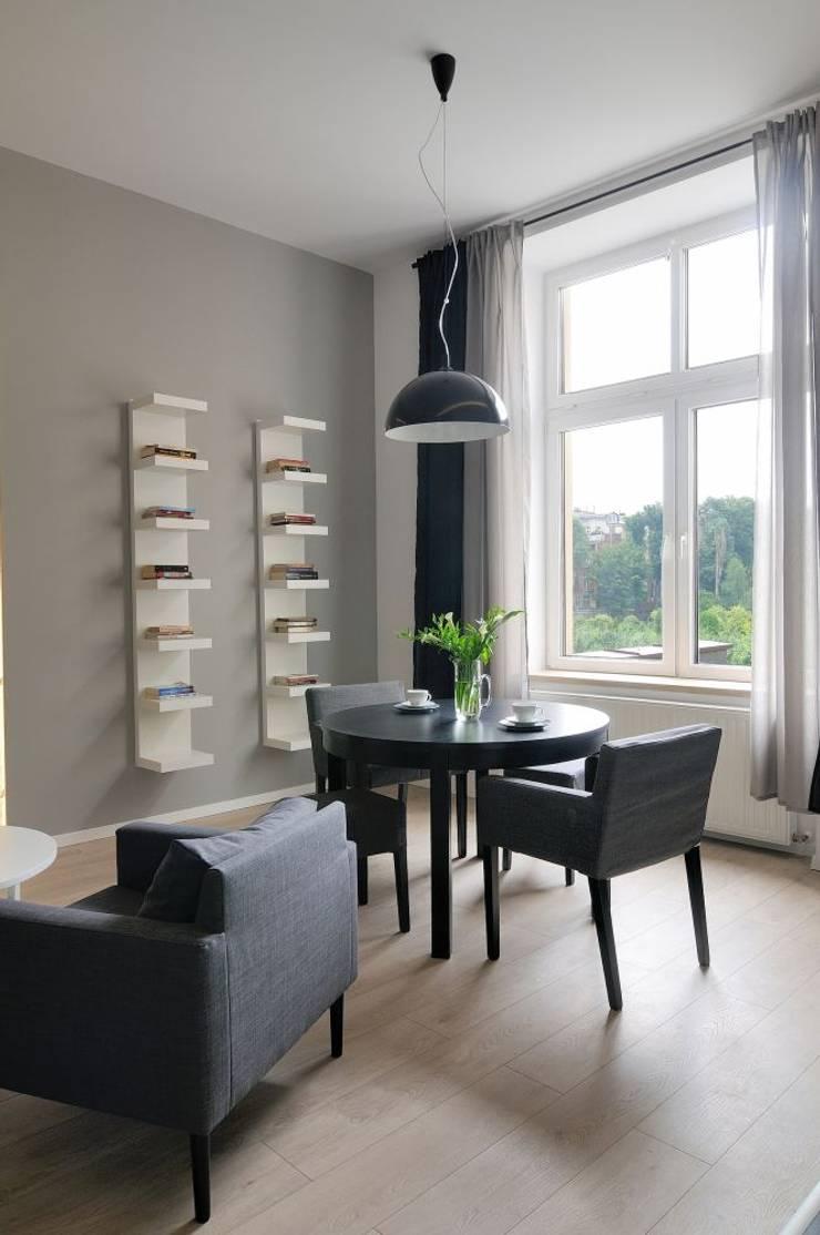 Apartament do wynajęcia w Krakowie : styl , w kategorii Jadalnia zaprojektowany przez ARTEMA  PRACOWANIA ARCHITEKTURY  WNĘTRZ ,Nowoczesny