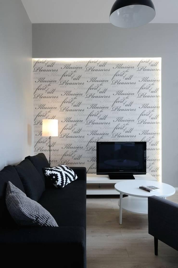 Apartament do wynajęcia w Krakowie : styl , w kategorii Salon zaprojektowany przez ARTEMA  PRACOWANIA ARCHITEKTURY  WNĘTRZ ,Nowoczesny