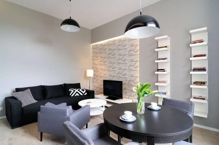 Apartament do wynajęcia w Krakowie : styl , w kategorii Salon zaprojektowany przez ARTEMA  PRACOWANIA ARCHITEKTURY  WNĘTRZ