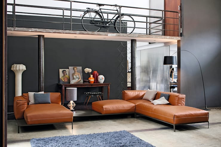industrial Living room by IMAGO DESIGN