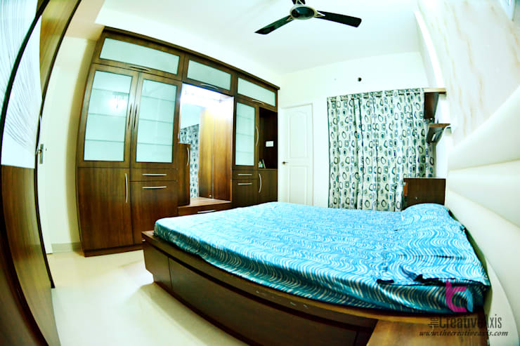 COZY APARTMENT IN COASTAL:   by Creative Axis Interiors Pvt. Ltd.
