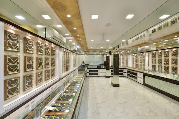 Retail Outlet:  Office spaces & stores  by Mykraaft Designers and Project consultants Private Limited