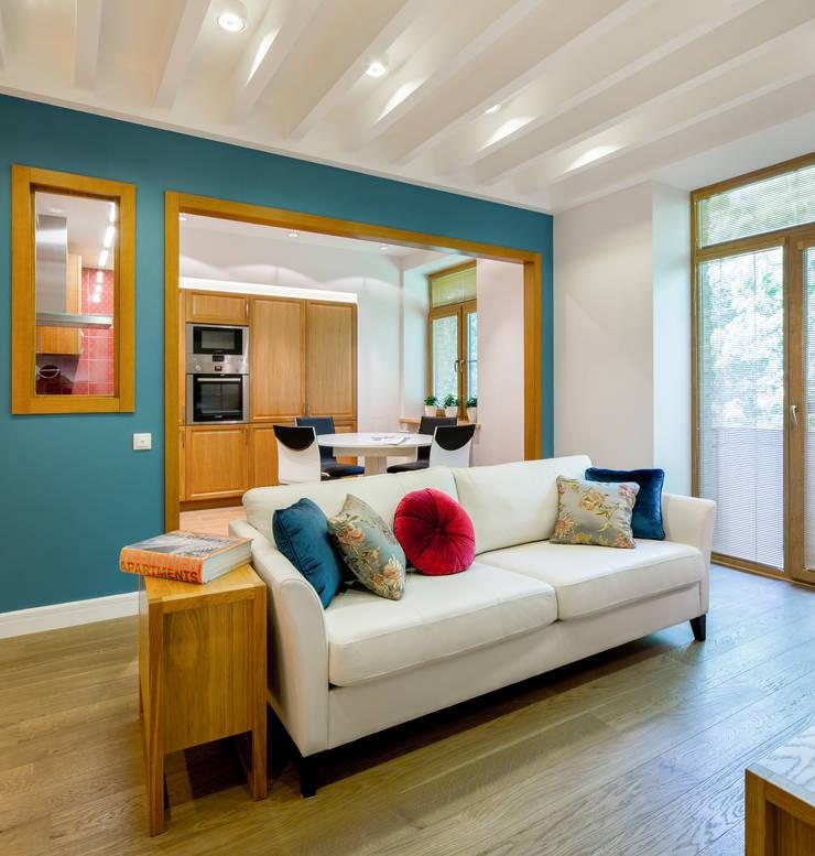 Апартаменты на Бирюзова: Гостиная в . Автор – Дизайн-студия 'Вердиз'