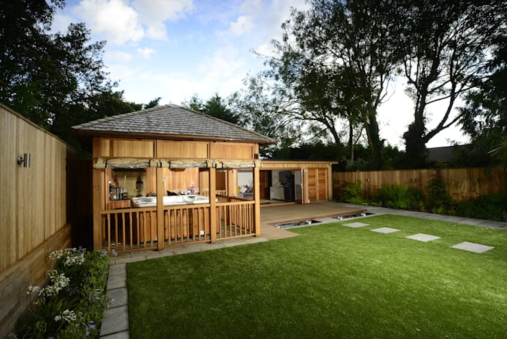 Bespoke garden building complete with spa and kitchen:  Garage/shed by Crown Pavilions