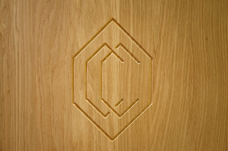 Detail of branding on champagne boxes:  Bars & clubs by Fraher Architects Ltd