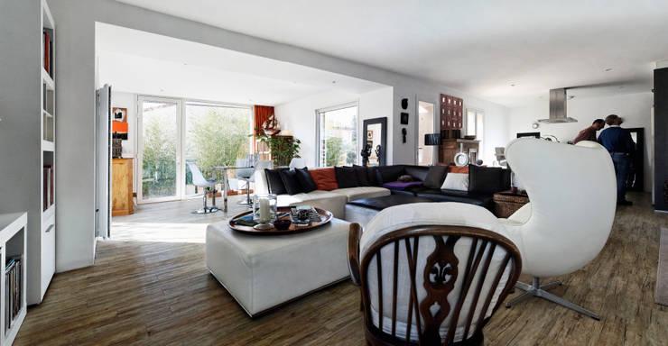 Une boite contemporaine et raffinée: Salon de style  par casa architectes