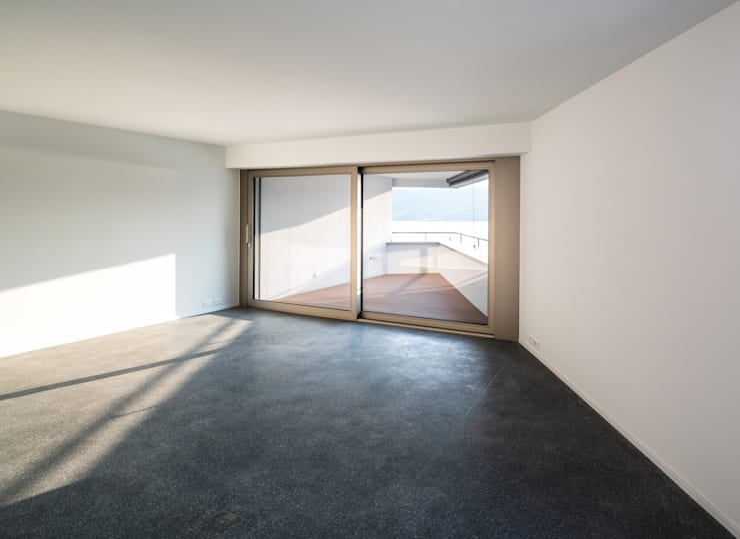 Mehrfamilienhaus 'Flair' in Herrliberg: moderne Wohnzimmer von AMZ Architekten AG   sia   fsai