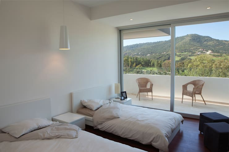 Residencial Vivalto: Recámaras de estilo  por Grupo Nodus Arquitectos