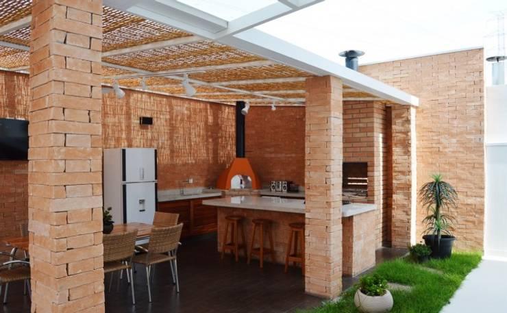 Área de Lazer: Terraços  por Vitor Dias Arquitetura,