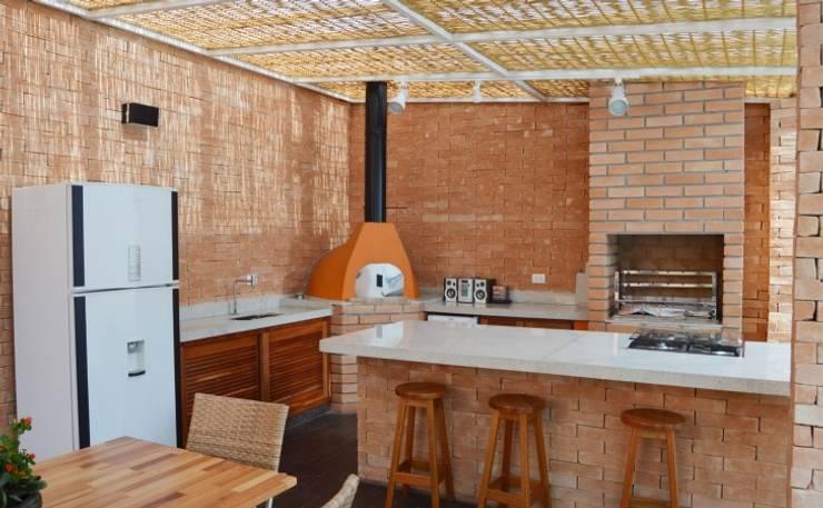 Iluminação: Terraços  por Vitor Dias Arquitetura,