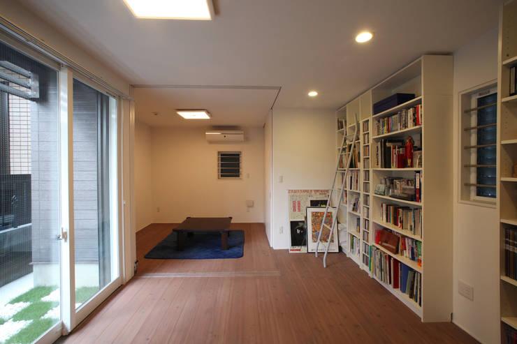ファミリールーム: atelier mが手掛けた和室です。