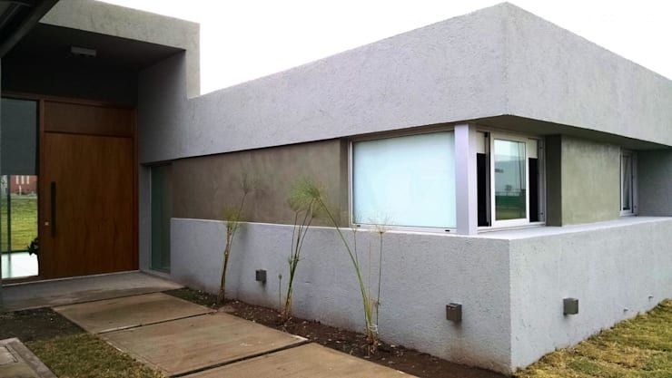 Houses by GANDIA ARQUITECTOS, Modern Stone