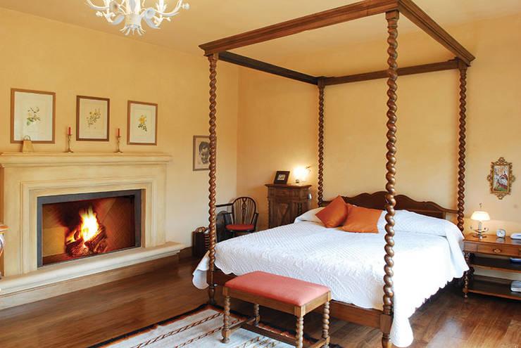 INTERIORES: Dormitorios de estilo  por JUNOR ARQUITECTOS