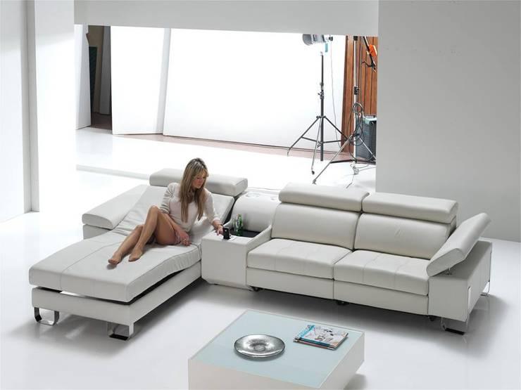 Sala de estar  por MUEBLES OYAGA