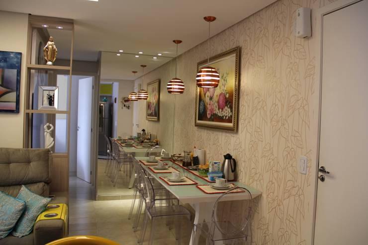 Residência Goiânia/GO: Salas de jantar  por Donakaza