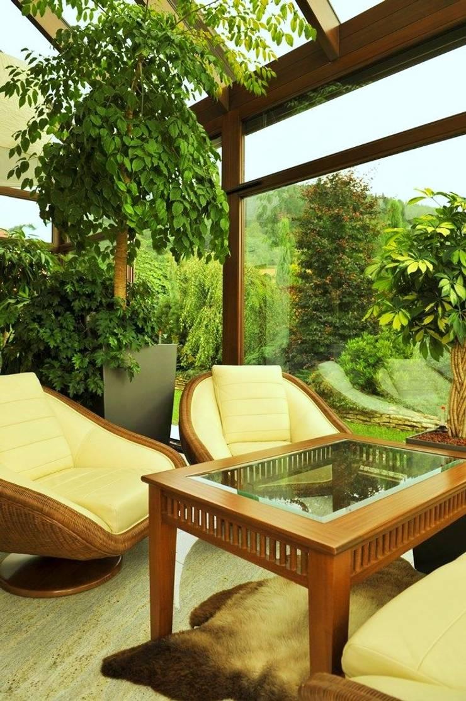 Ogród zimowy: styl , w kategorii Ogród zimowy zaprojektowany przez Pracownia Projektowa Architektury Krajobrazu Januszówka