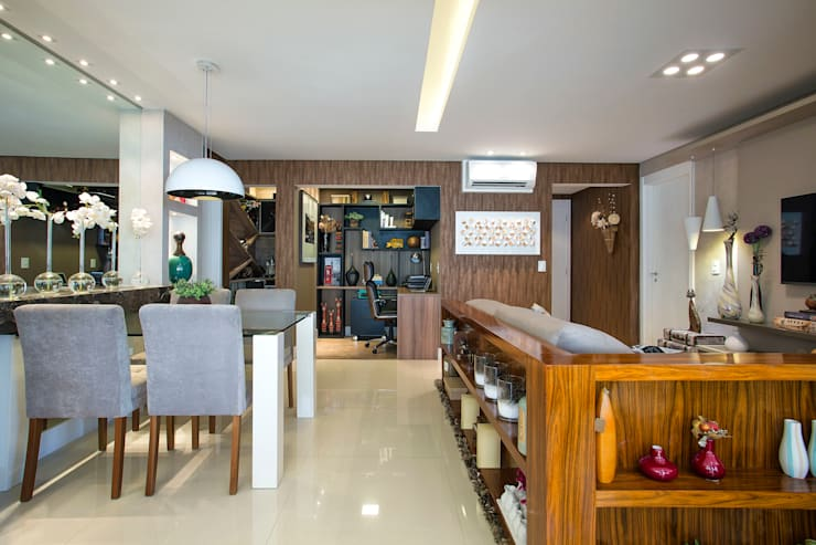 Ambientes Integrados: Salas de estar ecléticas por Adriana Pierantoni Arquitetura & Design