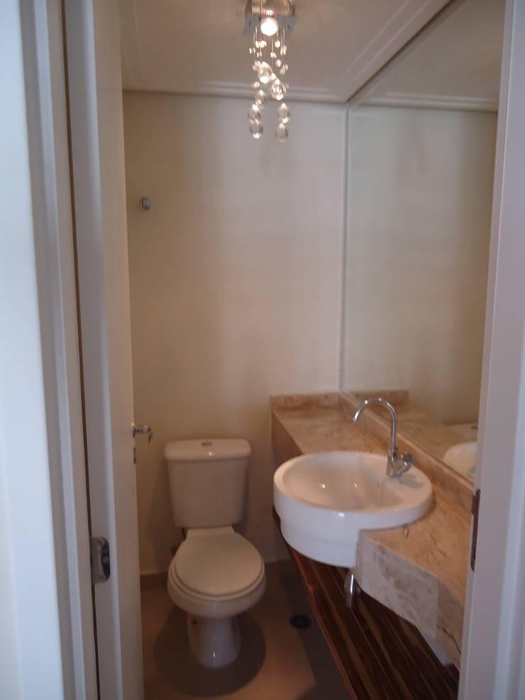 Apartamento tipo Cobertura Granja Julieta: Banheiros  por VT Design - Arquitetura e Interiores,Rústico Mármore