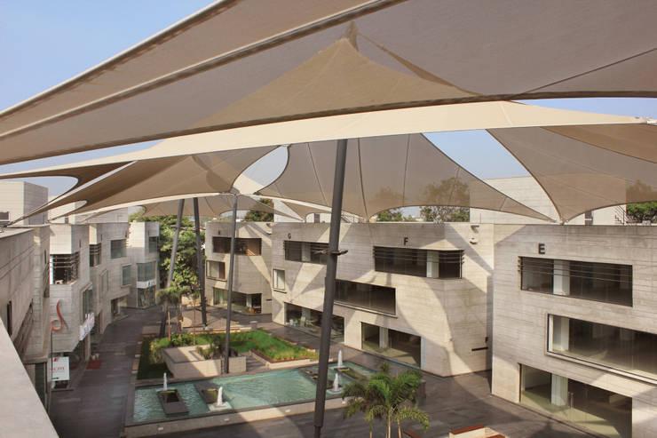 Mondeal Retail Park:  Commercial Spaces by Blocher Blocher India Pvt. Ltd.