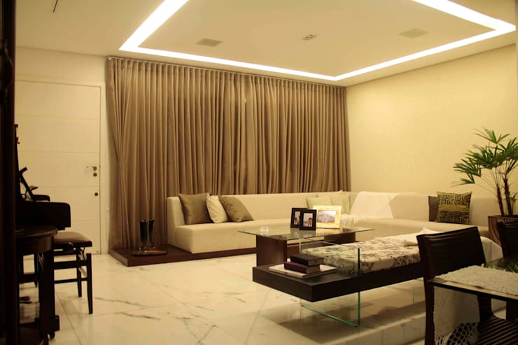 Casa Liberdade: Salas de estar  por Na Lupa Design