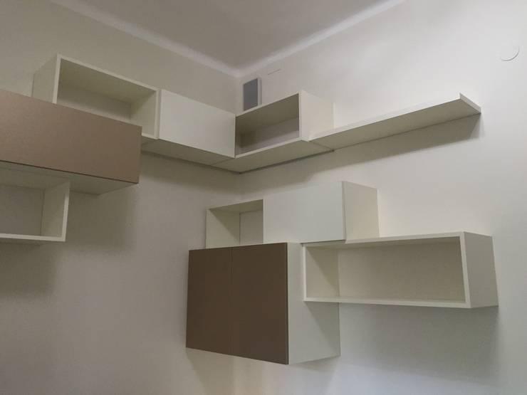 Progetto libreria per studio professionale: Studio in stile  di Arreda Progetta di Alice Bambini,