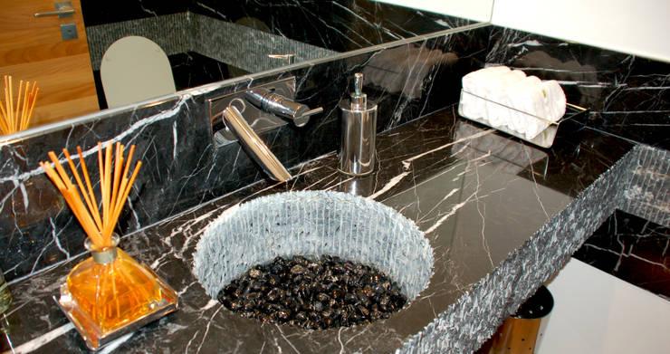 Detalhe Lavabo: Banheiros  por Peixoto Arquitetos Associados ,