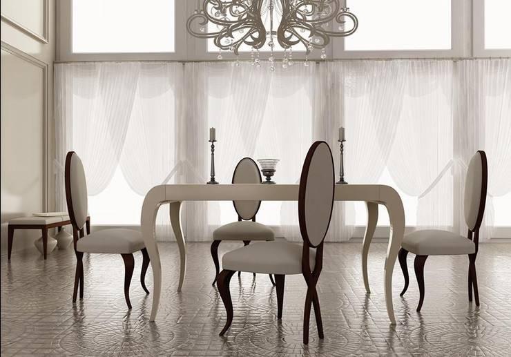 Sala de jantar  por MUEBLES OYAGA