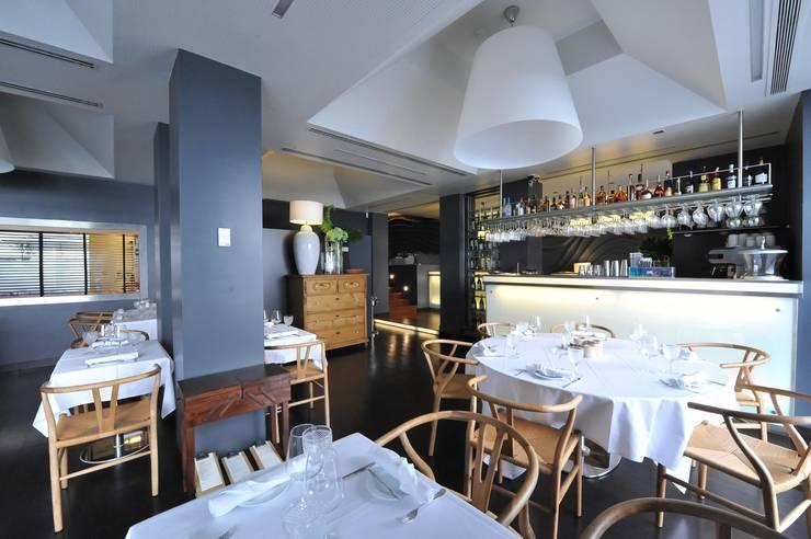 Restaurante: Espaços de restauração  por Gavetão- Decoração de Interiores