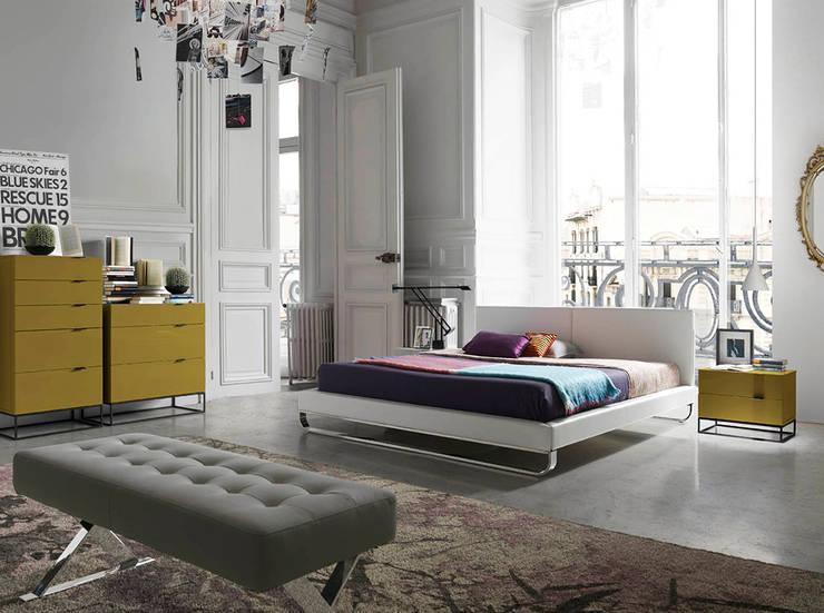 DORMITORIOS: Dormitorios de estilo  de MUEBLES OYAGA