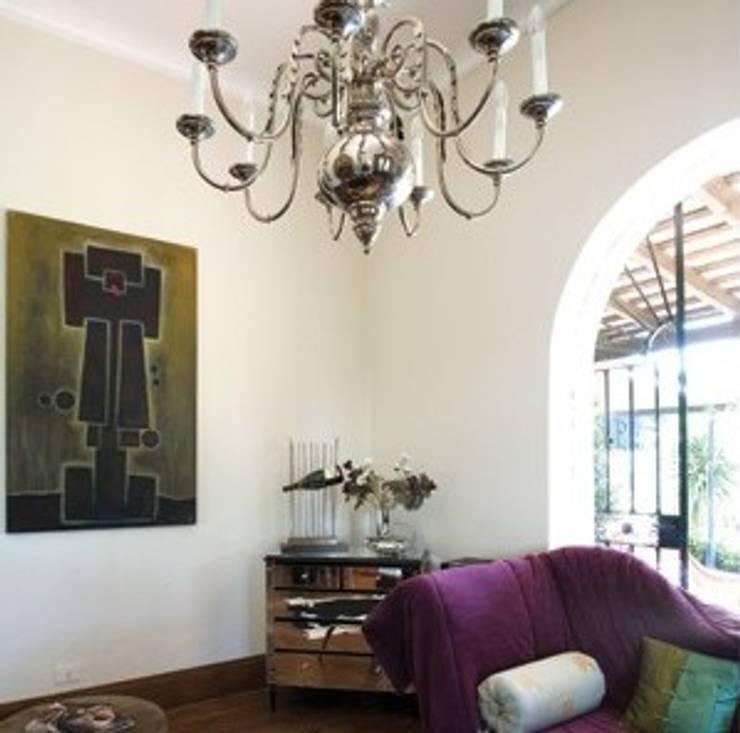 espacios con arte Salones rústicos rústicos de Daniel Vidal Rústico Caliza