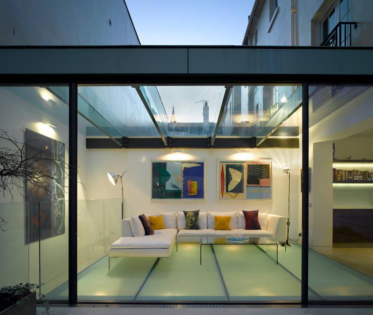 Park Village West:  Living room by Belsize Architects