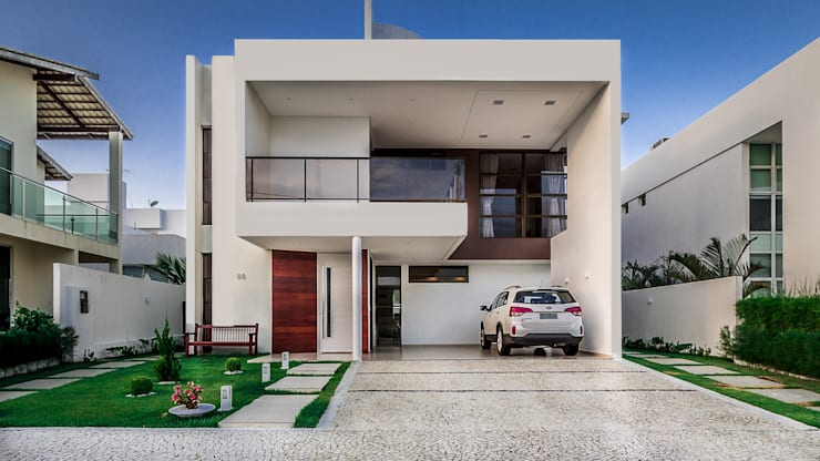 Casas de estilo minimalista por Lyssandro Silveira