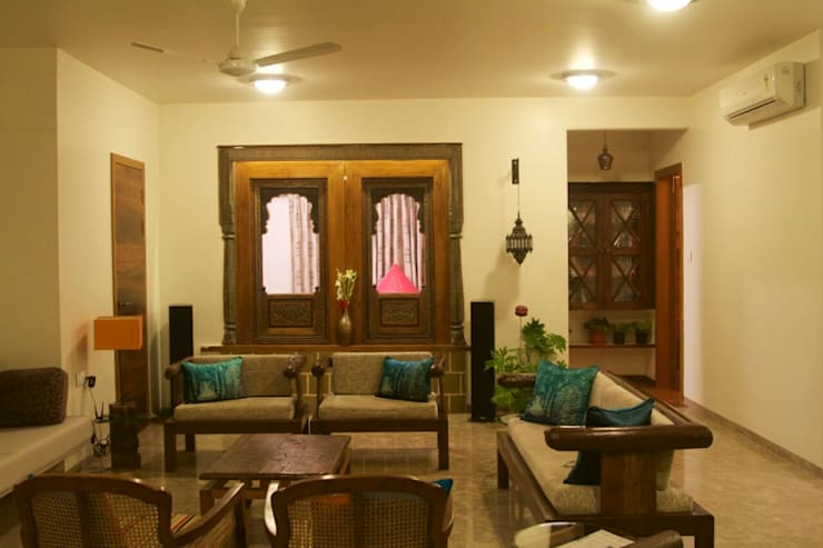 interior project : residential apartment: asian Living room by uttara and adwait furniture