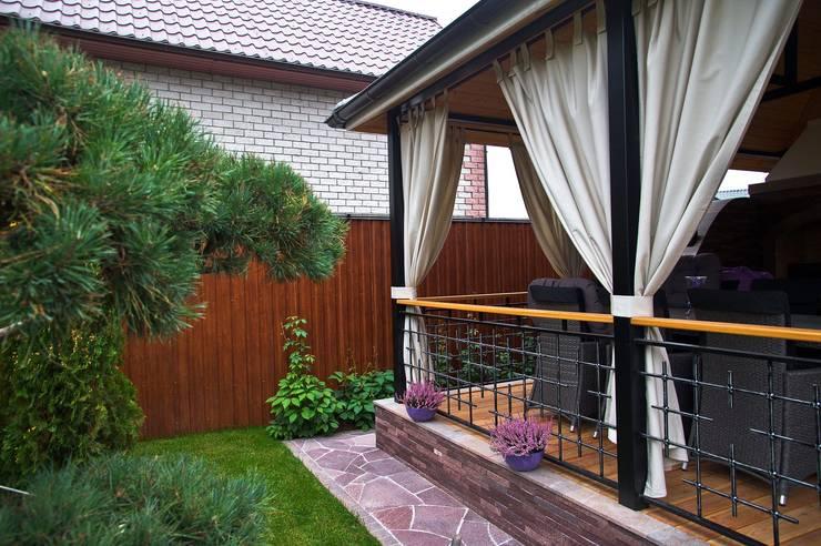 Balcones y terrazas de estilo  de DECOR OUTDOOR