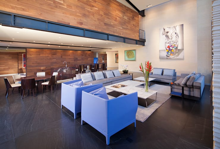 Casas La Punta: Salas de estilo  por grupoarquitectura