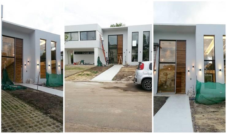 Casa D+L: Casas de estilo  por Indinaco srl Construcciones y servicios
