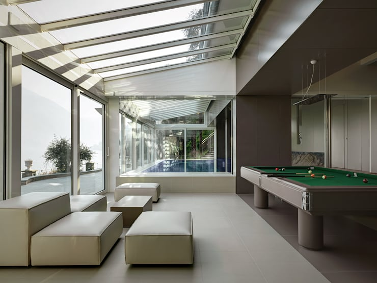 Villa T: Terrazza in stile  di arkham project