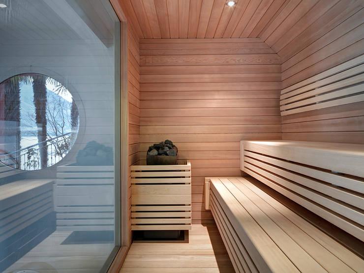 Villa T: Spa in stile in stile Moderno di arkham project