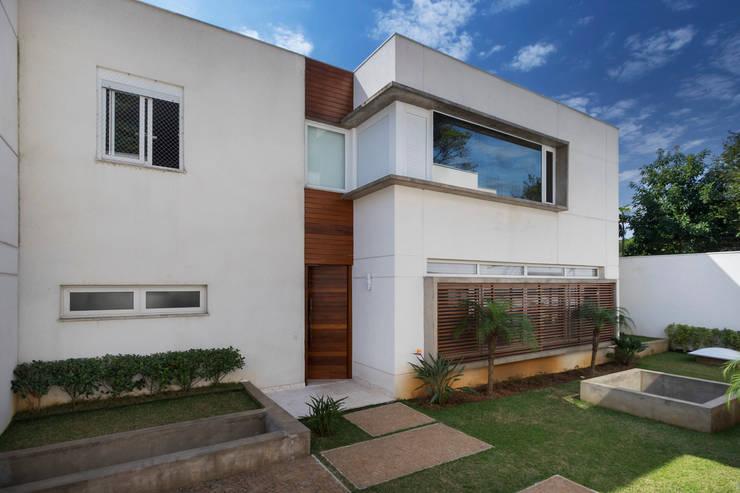 Casa Brooklin: Casas  por Cactus Arquitetura e Urbanismo
