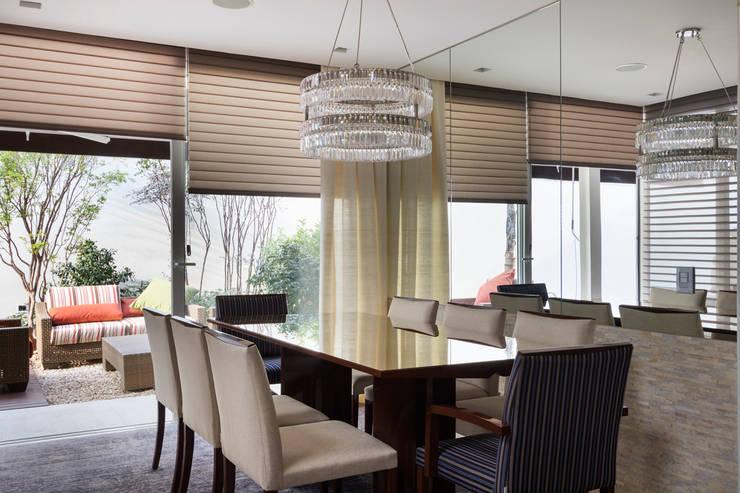 Dining room by Cactus Arquitetura e Urbanismo