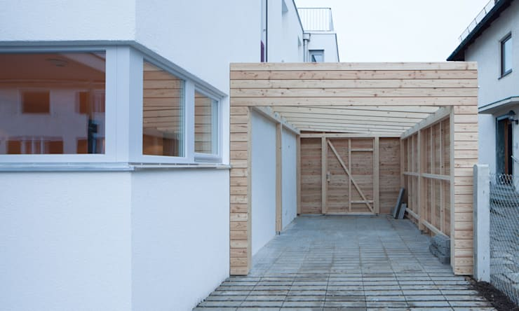 modern Garage/shed by MuG Architekten