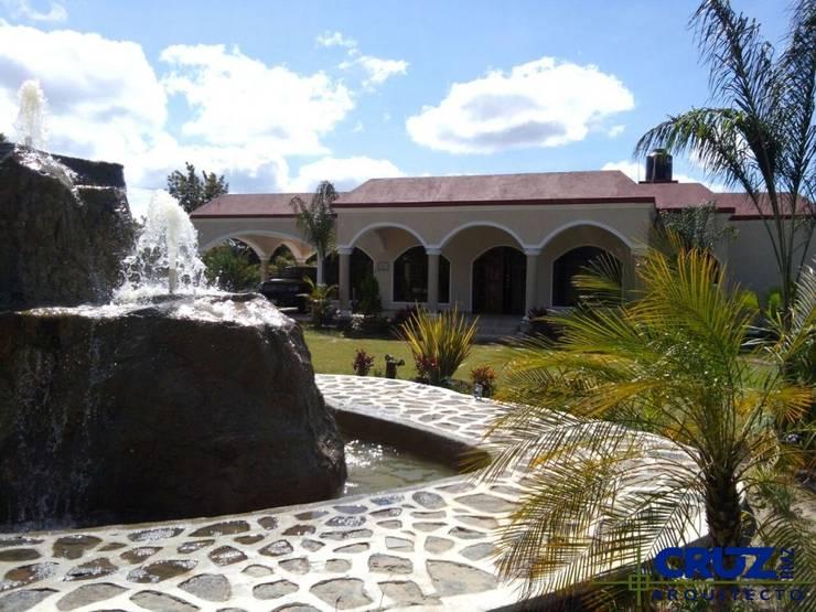 Casa Atlixco: Casas de estilo  por Cruz Arquitectos       Proyectos y Avaluos