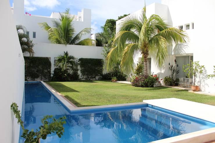Casa habitacion en en Cozumel Quintana Roo: Casas de estilo  por A2 HOMES SA DE CV
