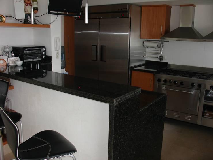 Casa habitacion en en Cozumel Quintana Roo: Cocinas de estilo  por A2 HOMES SA DE CV